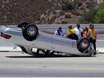 Overturned Vehicle Snarls Freeway Traffic