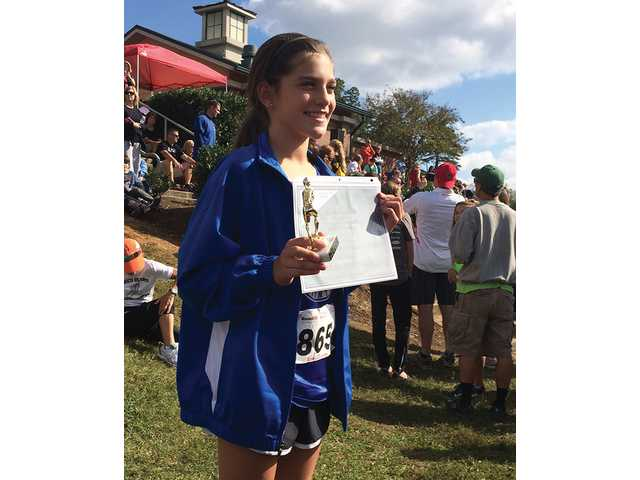 Saints Cross Country runner honored