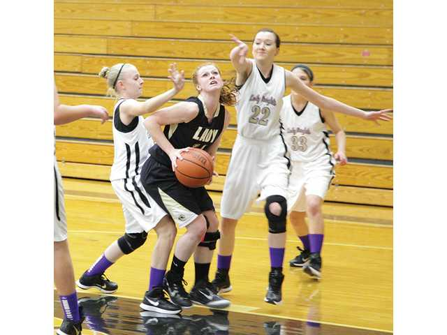 Lady Tigers dominate court