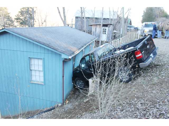 McFall airlifted after crashing into house