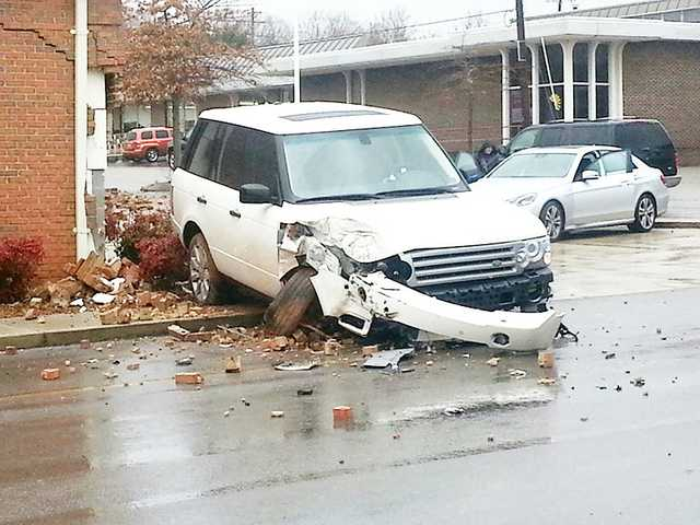 Range Rover crashes into law office