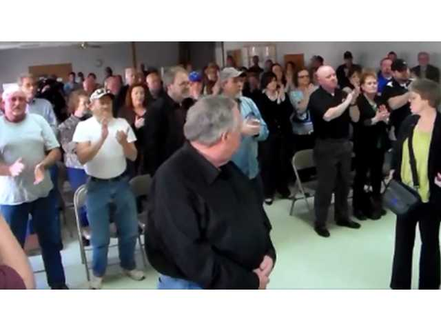 Crowd turns out to support police chief