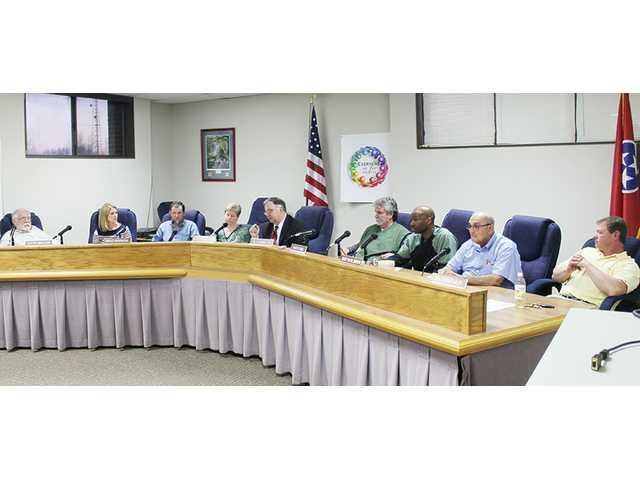 School board seeks to oust director earlier than planned