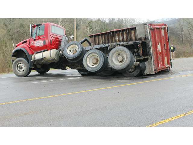 Dump truck loses load on Highway 70