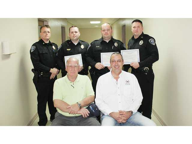 City policemen commended