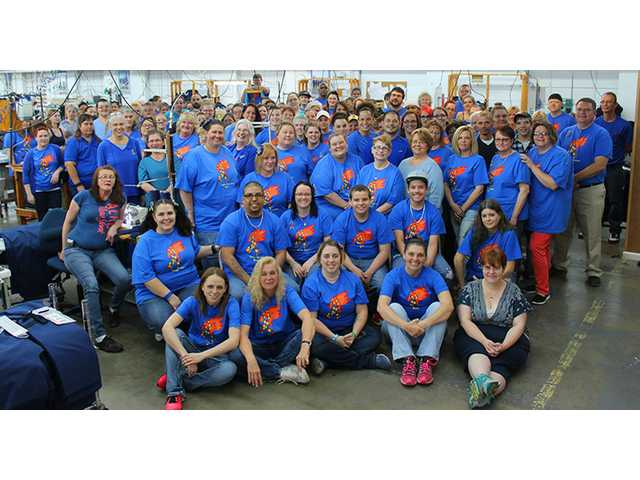 Omega Apparel goes blue for autism