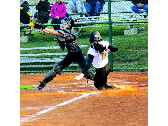Tigerettes win first game of tourney