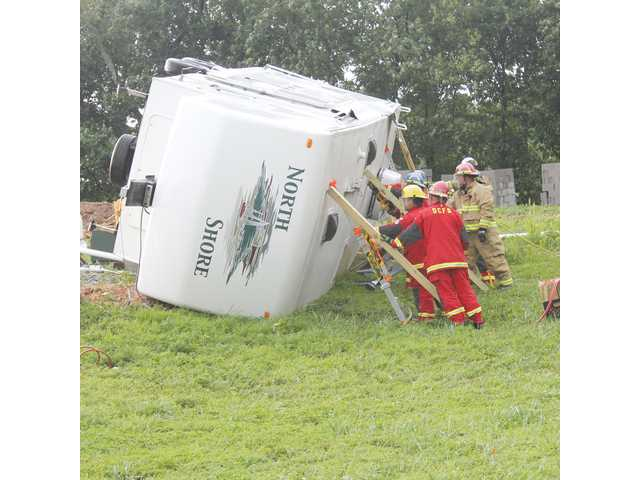 Three injured in overturned trailer