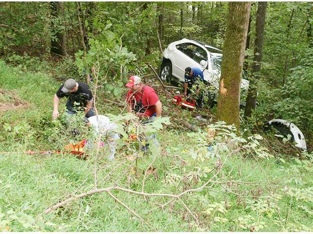 Woman uninjured in rollover