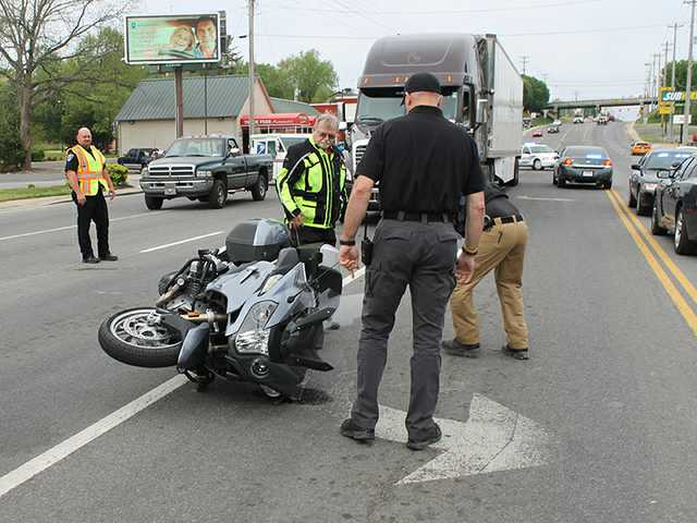 Biker airlifted after tangling with semi