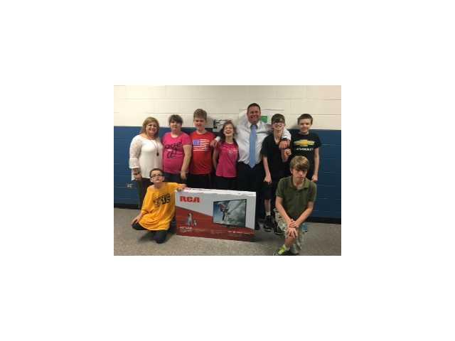 RunDown 5K presents DeKalb schools with donations