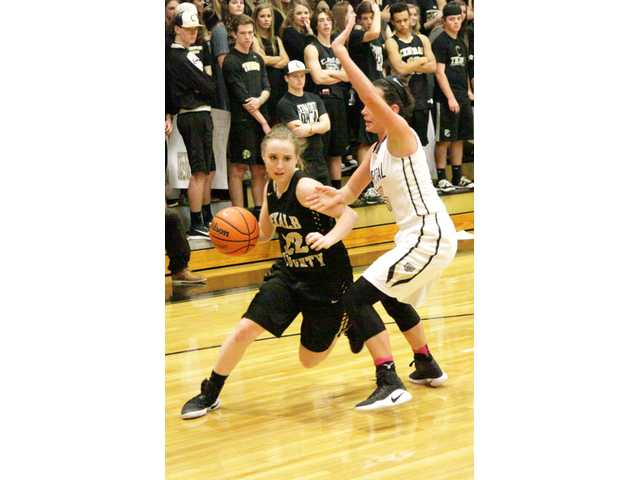 Lady Tigers lose overtime battle