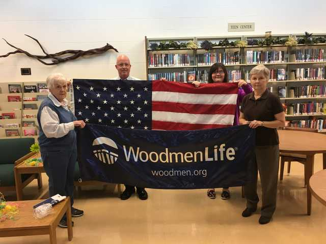 Woodmen donate flag