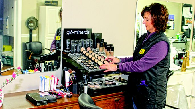 """Steve Warner photos Headlines Hair Design owner J.J. Poss stocks a display of top-notch hair products sold at the location which include Glo, Paul Mitchell, Matrix and more."""""""