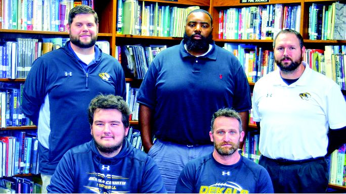 Steve Warner photo DCHS Football Senior Gage Delape has signed to play at Lindsey Wilson College in Kentucky. Front row, from left, Delape and Tiger head coach Steve Trapp. Second row, assistants Thomas Cagle, Justin Burum and Tommy Hinch.