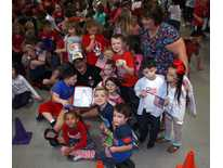 SES students sing God Bless the USA to Veterans Friday