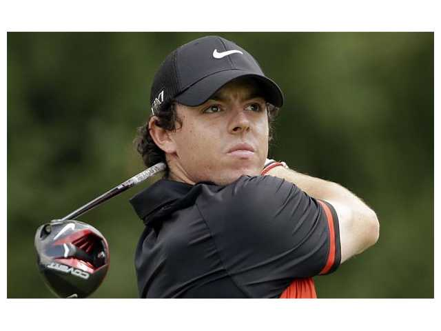 Rory McIlroy surges to lead with 67 at soggy PGA