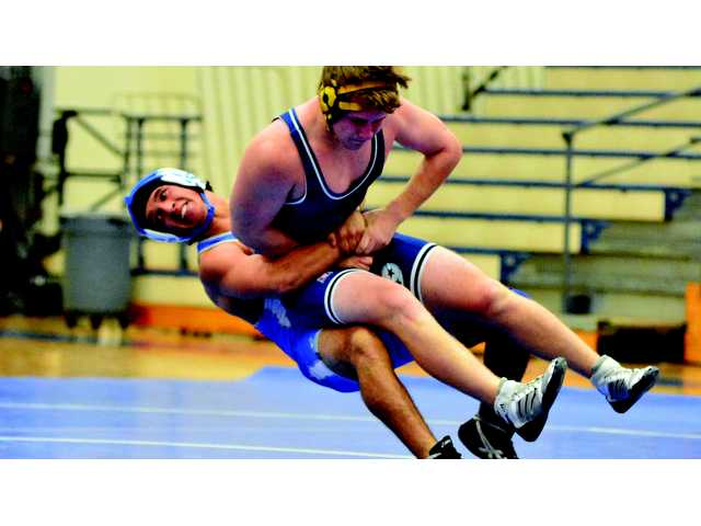 Warren wrestlers thrown for loss
