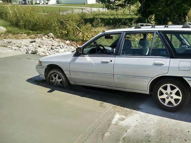 Wet concrete traps motorist