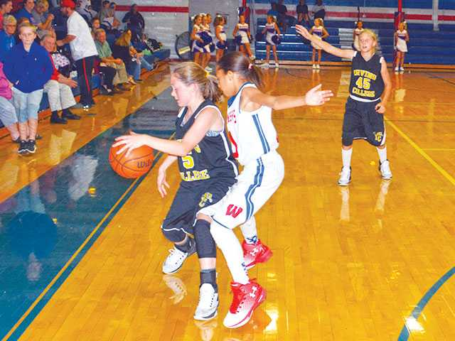 Lady Pioneers win close one
