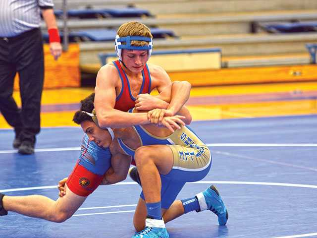 Shorthanded wrestling team comes up shy