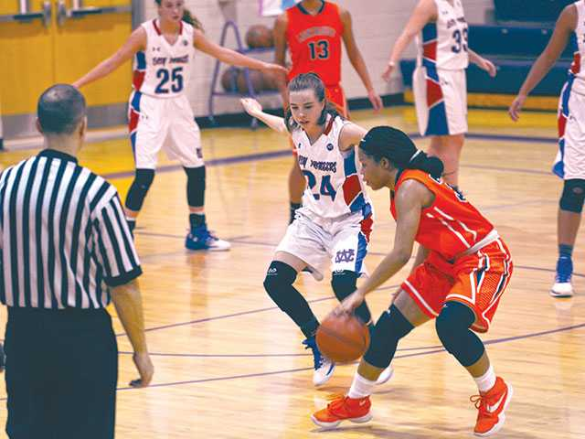 Lady Pioneers light up Lighthouse