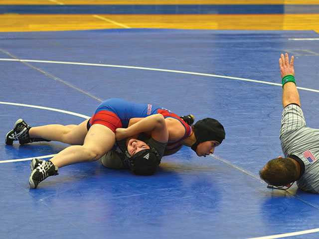 Wrestling team in compromising position