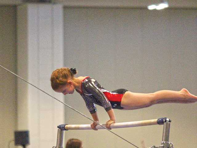 Bratcher flips for gymnastics
