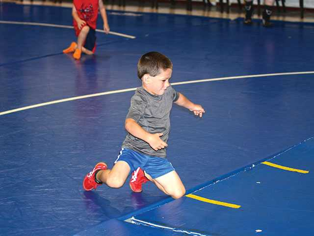 Campers grapple with wrestling lessons