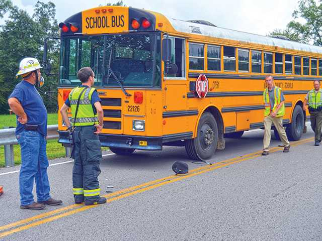 Teen hurt as SUV hits school bus