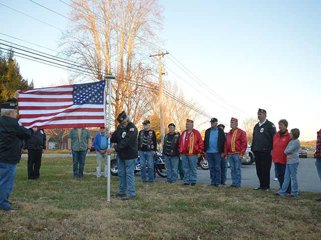 Veterans present American flag to Kids of the Community