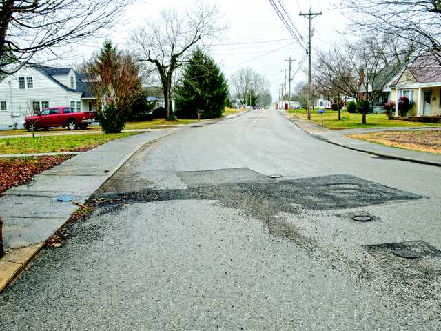 Costs could curb city paving plans