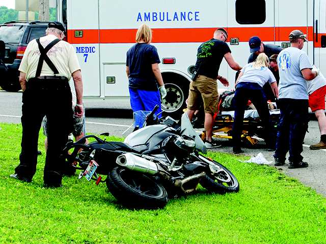 Motocycle rider struck by pickup