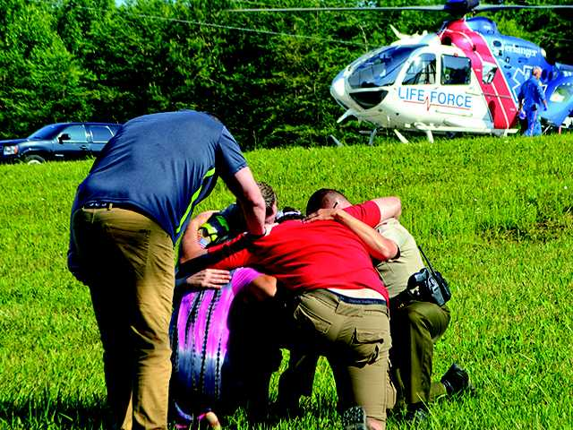 Teen airlifted after side-swiping semi