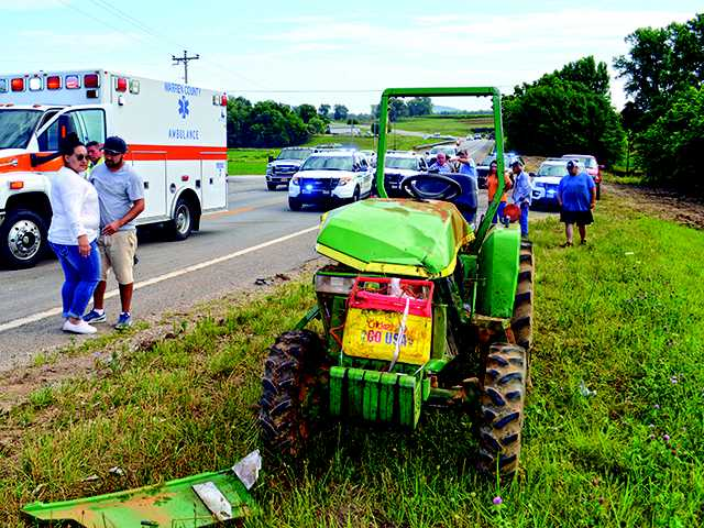 SUV rear-ends tractor