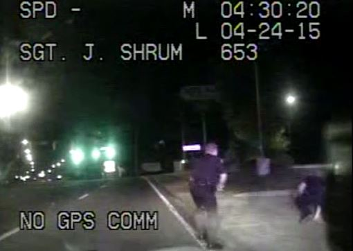 In-car police video of policeman being dragged