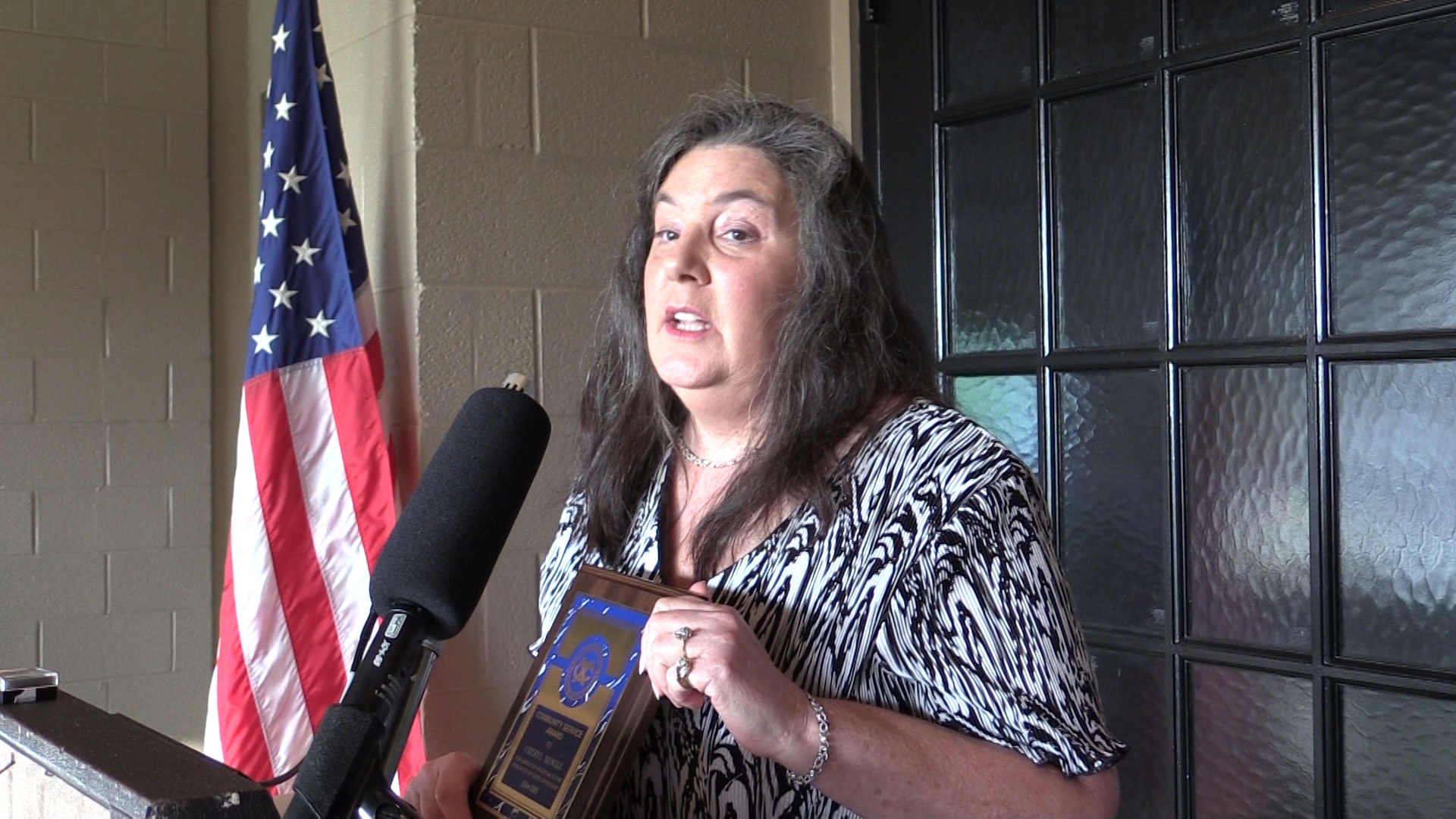Cheryl Mingle receives the Exchange Community Service Award
