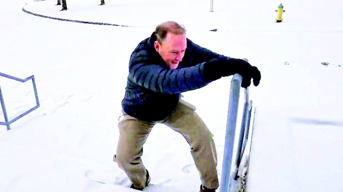 Bobby Cox is shown in the video trying to make his way up steps at WCMS. Schools are closed Friday.