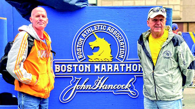 Tommy Kell and Jamez Zahn, right, pose near the starting line  before this year's Boston Marathon.