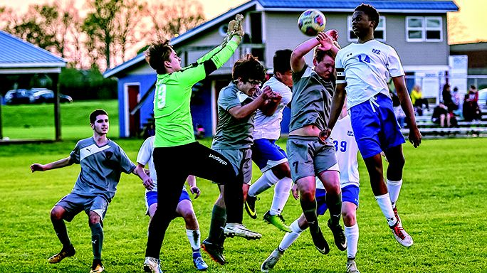 Jerry Mrema, right, rises to try to score on a corner kick during Tuesday's match. Warren County downed White County 4-0.