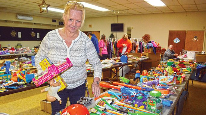 Tables of toys: Family orchestrates toy giveaway