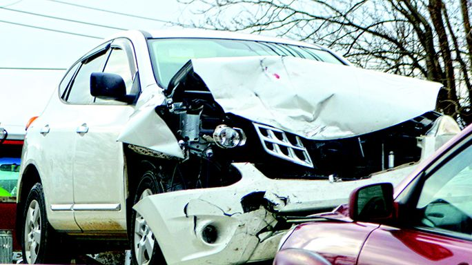 The white Nissan Rogue is pictured on the back of a wrecker after reportedly getting hit head-on by a maroon Kia on Wednesday morning.