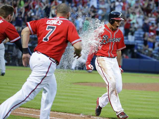 Braves top Brew Crew in extra innings