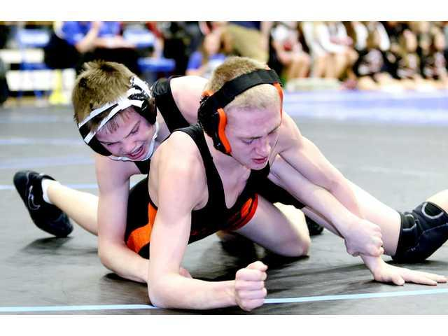 Two WarBirds lock up berths at state wrestling meet