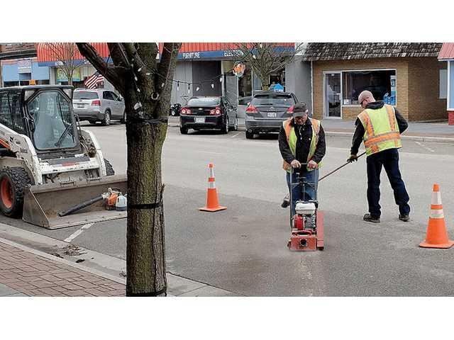 City removes 11 downtown parking spaces