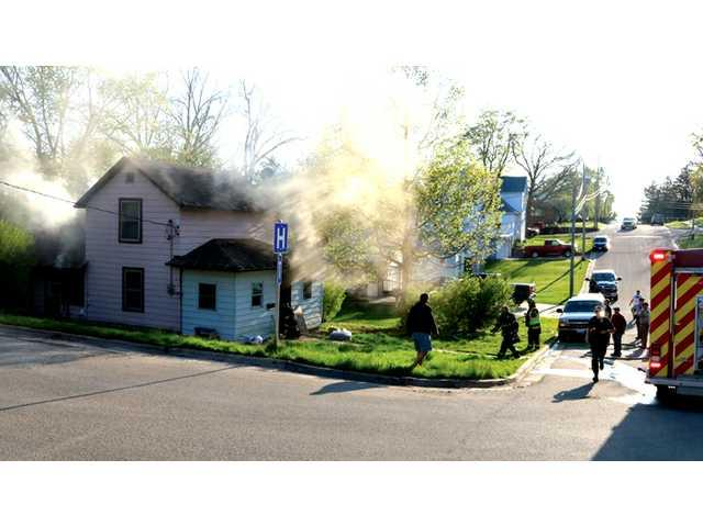 Fire reveals drugs and loaded gun in home