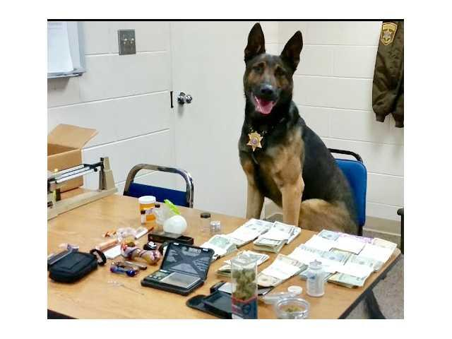 Cash, drugs confiscated following vehicle crash