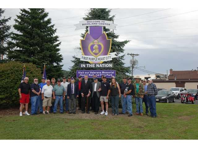 First Purple Heart City acknowledged with sign