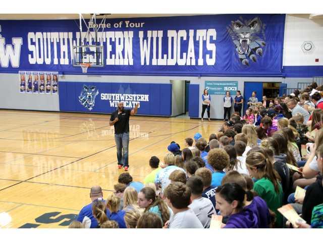 Former professional football player challenges students