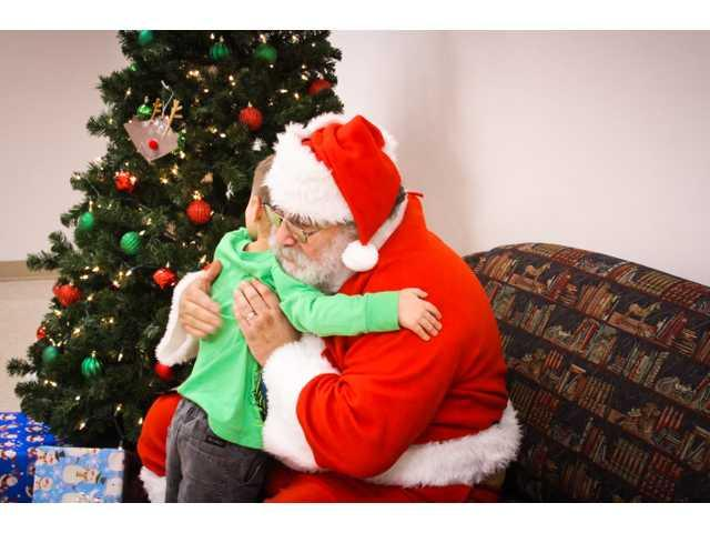 Kids and others meet Santa at Brewer Library